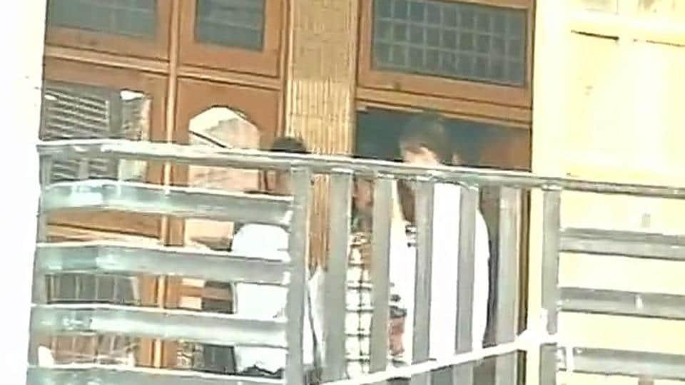 NIA officials at Devinder Singh Behl's residence.