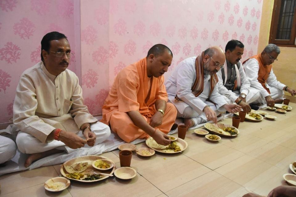 BJPchief Amit Shah and Uttar Pradesh chief minister Yogi Adityanath at lunch at   the residence of a booth level worker of the party in Lucknow.