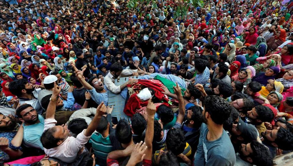 People shout slogans as they gather around the body of Shabir Ahmad Mir, a suspected militant who was killed in a gunbattle with security forces in Pulwama district.