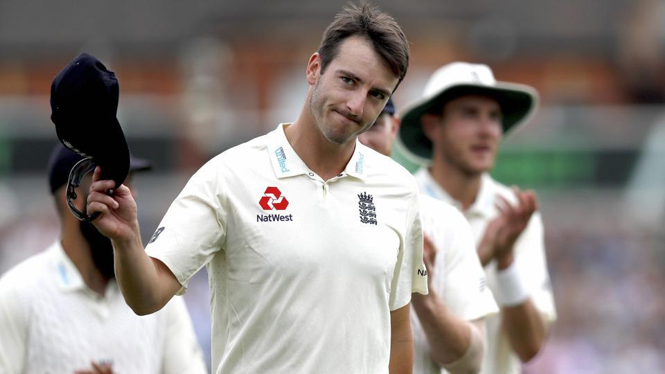 England's Toby Roland-Jones holds up his hat to applause as he leaves the pitch after taking the wicket of South Africa's Temba Bavuma on the third day of the third test match.