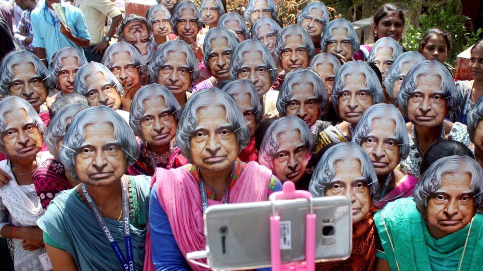 Women's College students wear masks of former president APJ Abdul Kalam to pay tribute to him on his 2nd death anniversary, in Coimbatore on Thursday (PTI)