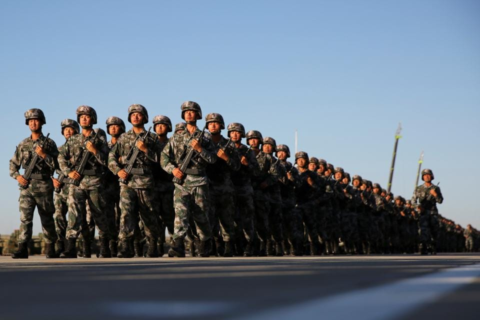 Soldiers at a military parade to commemorate the 90th anniversary of the foundation of China's People's Liberation Army at the Zhurihe military training base in Inner Mongolia Autonomous Region, China on July 30, 2017.