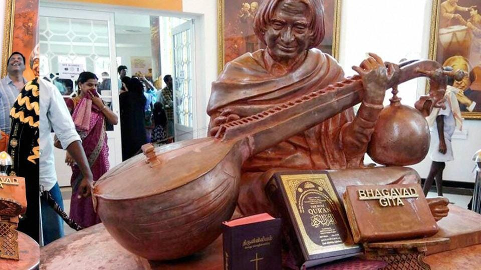 Copies of Bible and Quran placed alongside a wooden piece engraved with the words Bhagavad Gita near a wooden statue of late former president APJ Abdul Kalam at his memorial in Rameswaram.