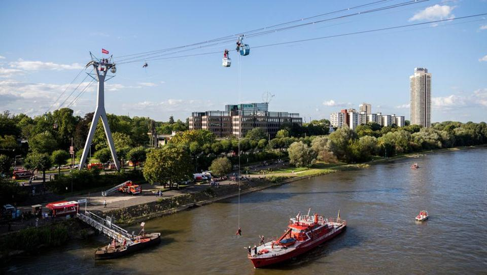 A man is roped down from a cable car gondola over the river Rhine in Cologne, Germany. (Photo: PTI/ DPA)