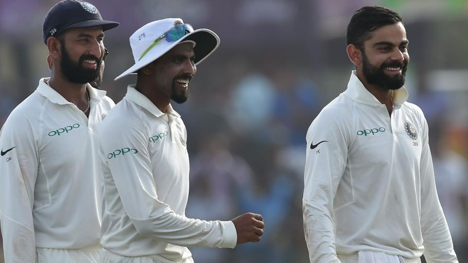 Indian cricket team captain Virat Kohli (R) and teammates leave the pitch after the fourth day of the first Test match against Sri Lanka at Galle International Cricket Stadium.