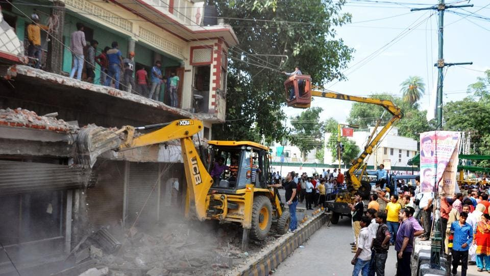 Local authorities carrying out the first phase of the anti-encroachment drive in Dehradun in June.