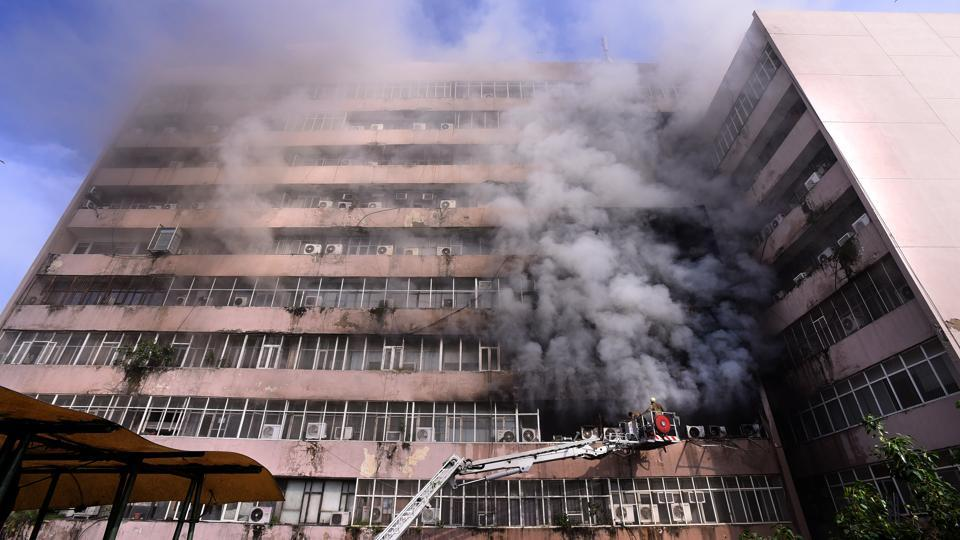 Firefighters try to douse flames at Delhi's Lok Nayak Bhawan after a blaze broke out on the building's fourth floor in New Delhi on Monday, July 24, 2017.  (Arun Sharma/HT PHOTO)