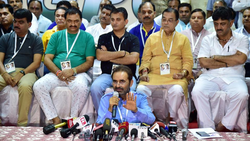 Congress spokesperson Shaktisinh Gohil speaks as Gujarat Congress MLAs are seated behind him during a press conference at a resort on the outskirts of Bengaluru on Sunday.