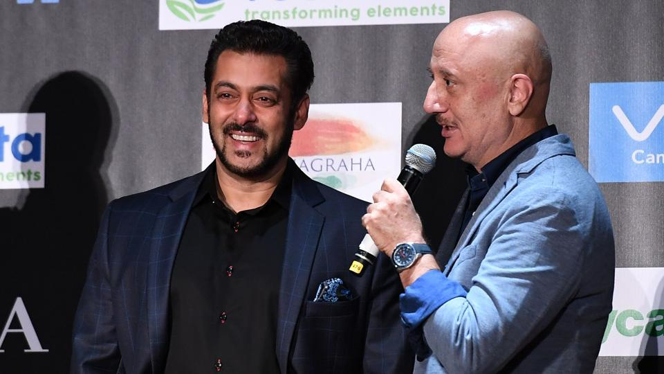 Salman Khan smiles as Anupam Kher speaks during a press conference ahead of the 18th International Indian Film Academy (IIFA) Festival in New York on July 13, 2017.
