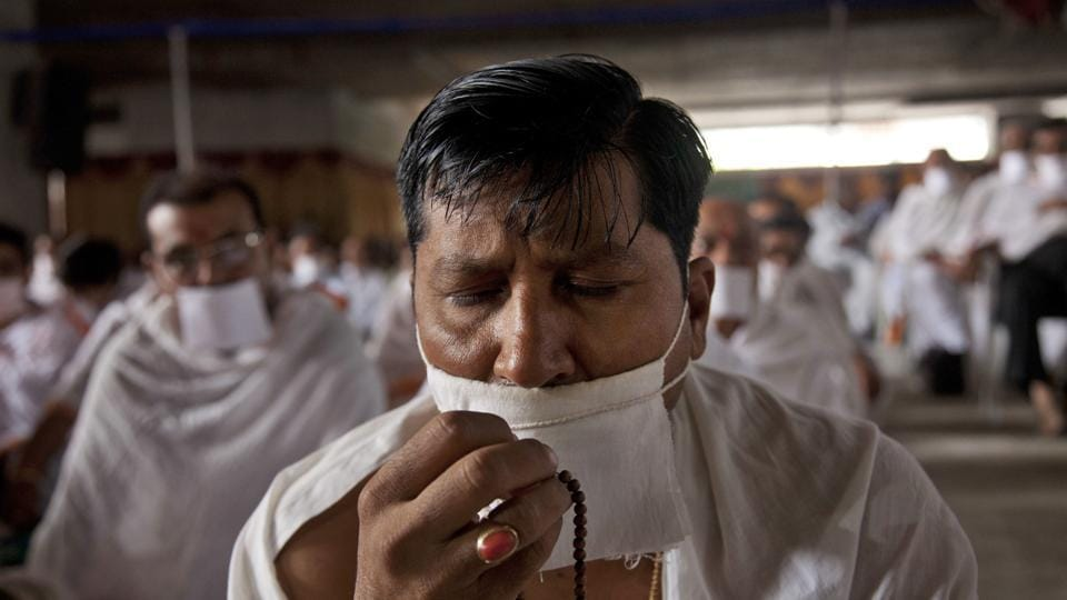 "An Indian Jain community member holds prayers beads as he gathers in support of members of their community who have been on a symbolic ""Fasting for world Peace'' for the past eight days in Hyderabad  Monday, July 24.  (AP/Mahesh Kumar A)"