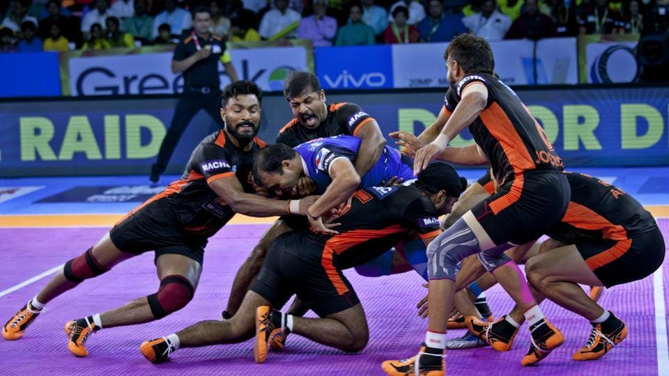 U Mumba's players pin down Haryana Steelers Wazir Singh, in blue, during their Pro Kabaddi League match in Hyderabad on Sunday.