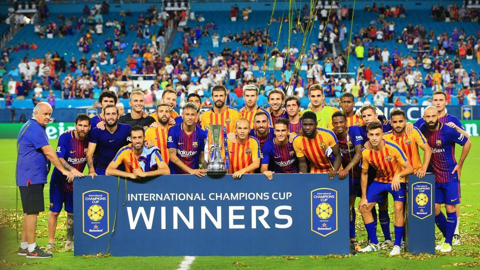 FC Barcelona celebrate with the trophy after defeating Real Madrid in their International Champions Cup 2017 match.