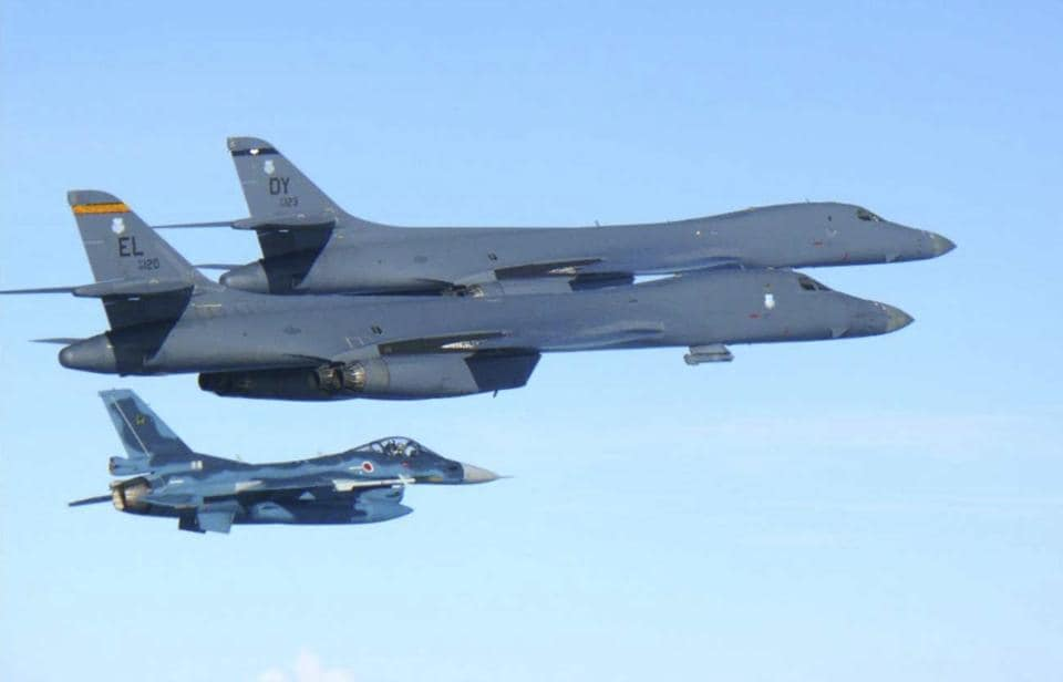 US Air Force B-1B bombers (top) fly with a Japan Air Self Defence Force F-2 fighter jet over Japan's southern island of Kyushu, just south of the Korean Peninsula, during a Japan-US joint exercise on Sunday.