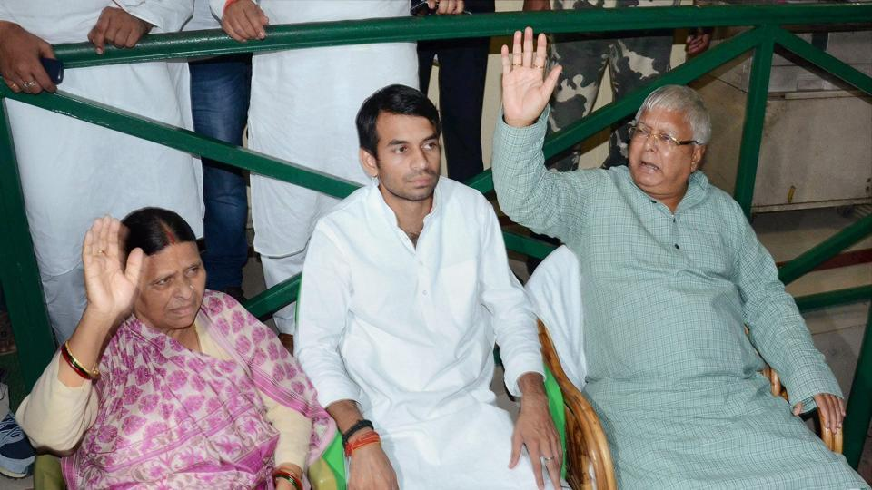 RJD chief Lalu Prasad with wife Rabri Devi and son Tej Pratap at a party meeting in Patna on Thursday.