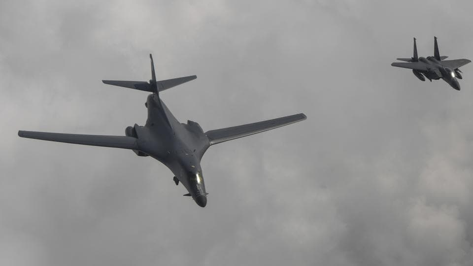 In this photo provided by South Korea Defense Ministry, a US Air Force B-1B bomber, left, flies with a South Korean fighter jet F-15K over the Korean Peninsula, South Korea on July 30.