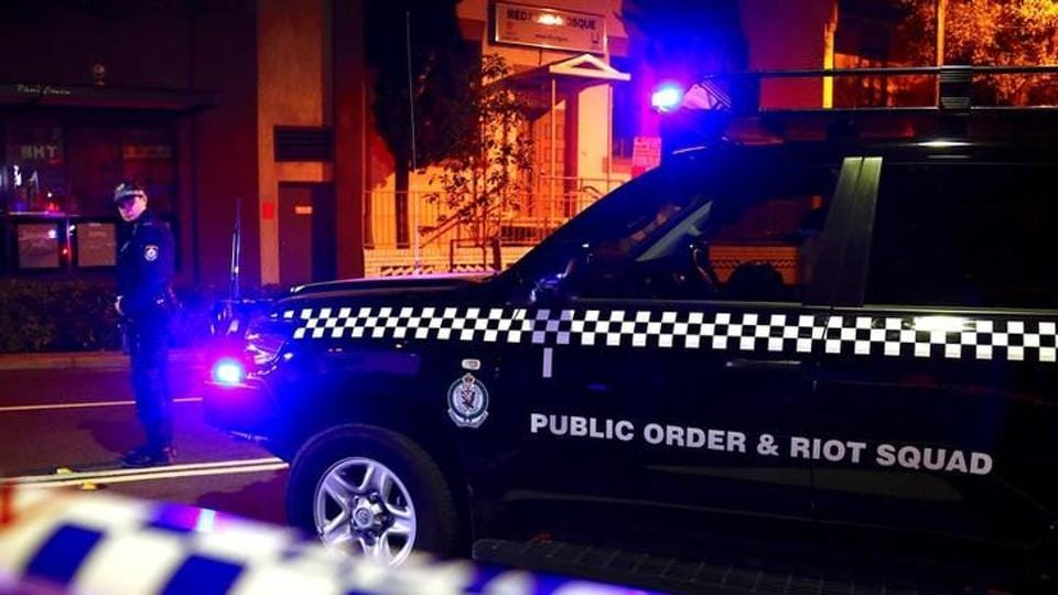 A policeman stands on a street that has been blocked to the public after Australian counter-terrorism police arrested four people in raids late on Saturday across several Sydney suburbs in Australia.