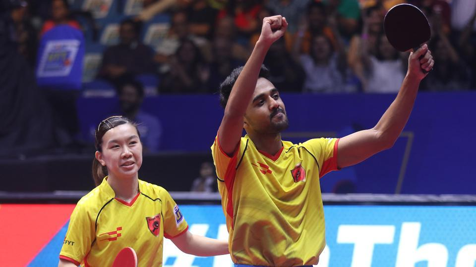Ho Ching Lee and Sanil Shetty of Falcons TTC celebrate after winning the inaugural Ultimate Table Tennis (UTT)league in Mumbai on Sunday.