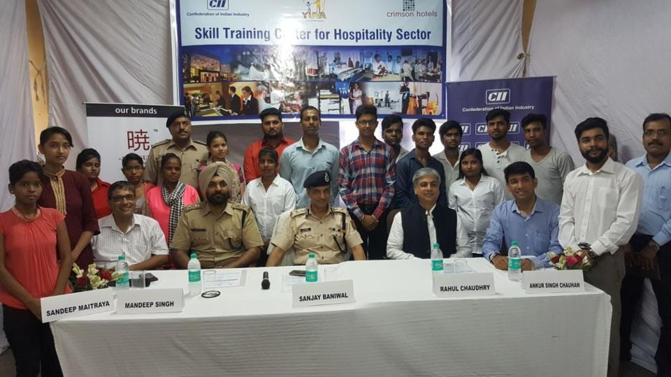 Officials of Delhi Police and Confederation of Indian Industry (CII) pose for a group photograph with the youngsters they have enrolled under Project Yuva.