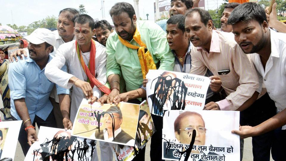 BJP supporters pour black ink over posters of former Uttar Pradesh minister Azam Khan in Patna after he made statements against the Indian Army.