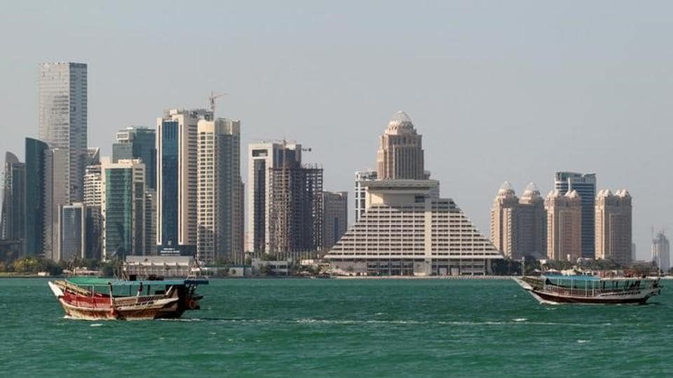 Buildings are seen on a coast line in Doha, Qatar.