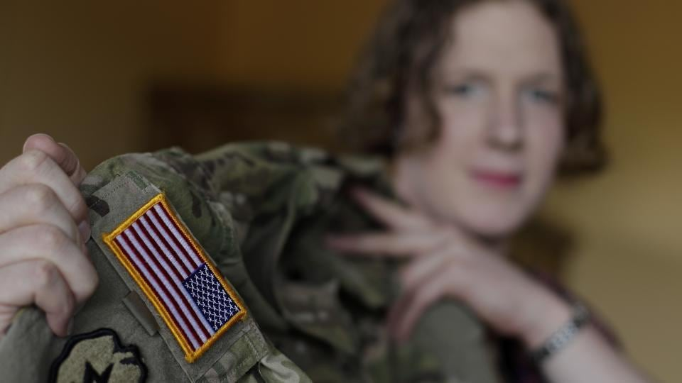 Transgender US army captain Jennifer Sims lifts her uniform during an interview in Beratzhausen near Regensburg, Germany.
