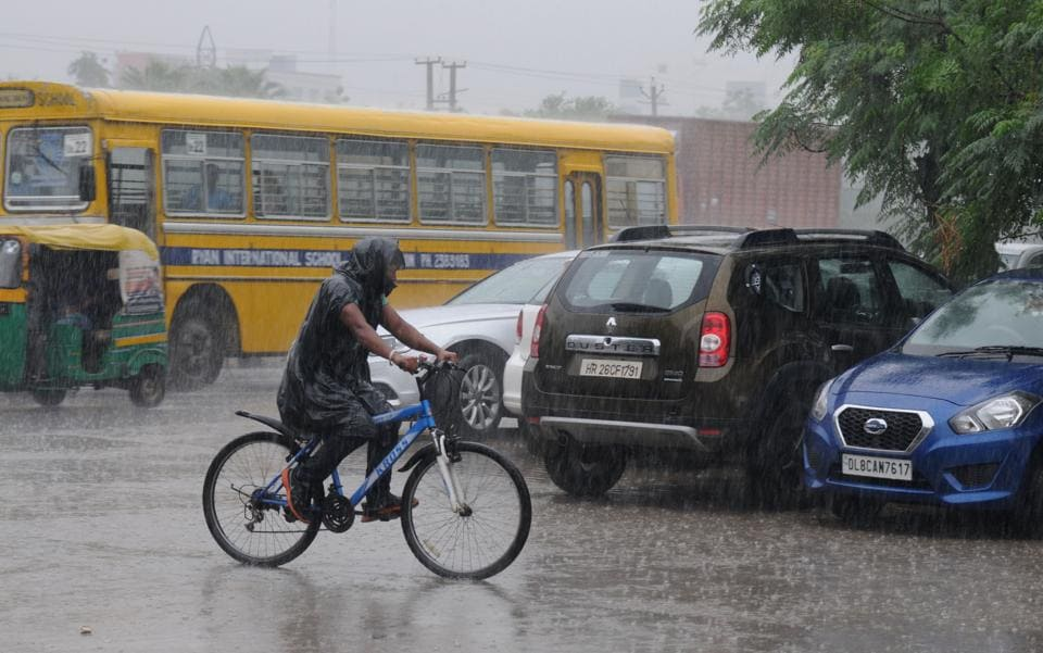 Commuters were caught unawares by the heavy rain in Gurgaon on Monday.