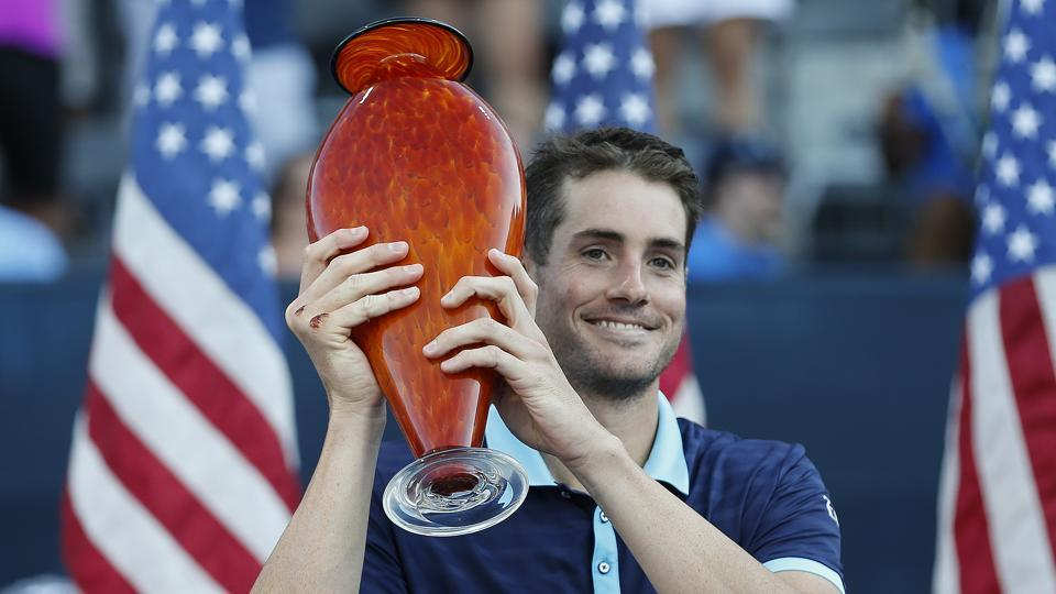 John Isner poses with the trophy after defeating Ryan Harrison in the finals of the ATPAtlanta Open.