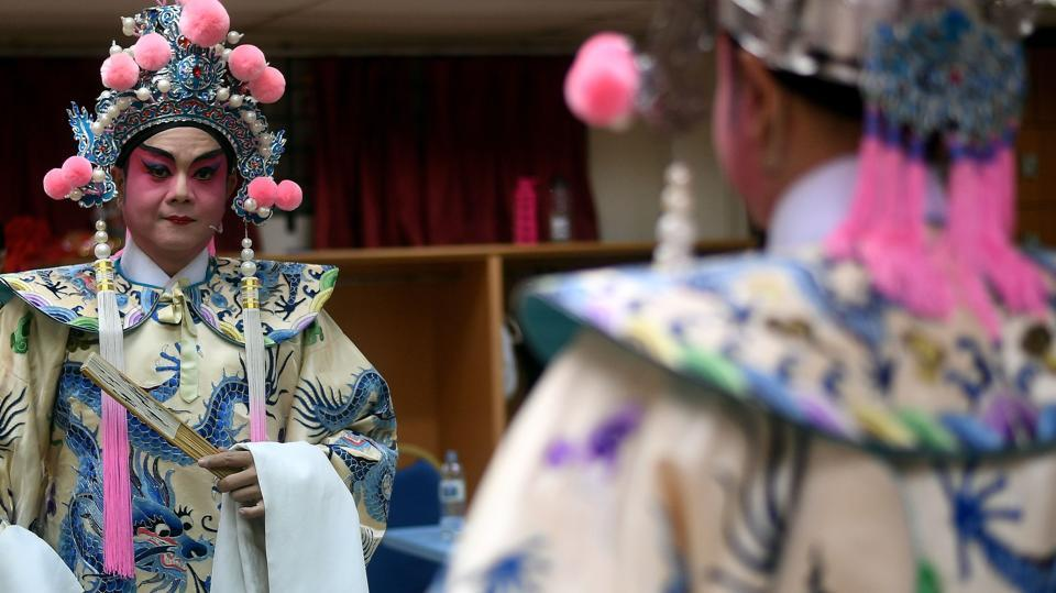 However, by the end of the 1930s, the turmoil caused by the Second Sino-Japanese War and the subsequent market collapse propelled the decline of Cantonese opera. (MANAN VATSYAYANA / AFP)