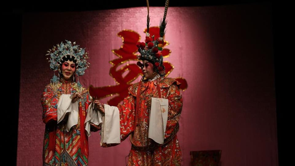 Actresses Veronica Davis (L) and Koh Lai Lin (R) from the Sound of Tai Hei group perform on stage . (MANAN VATSYAYANA / AFP)
