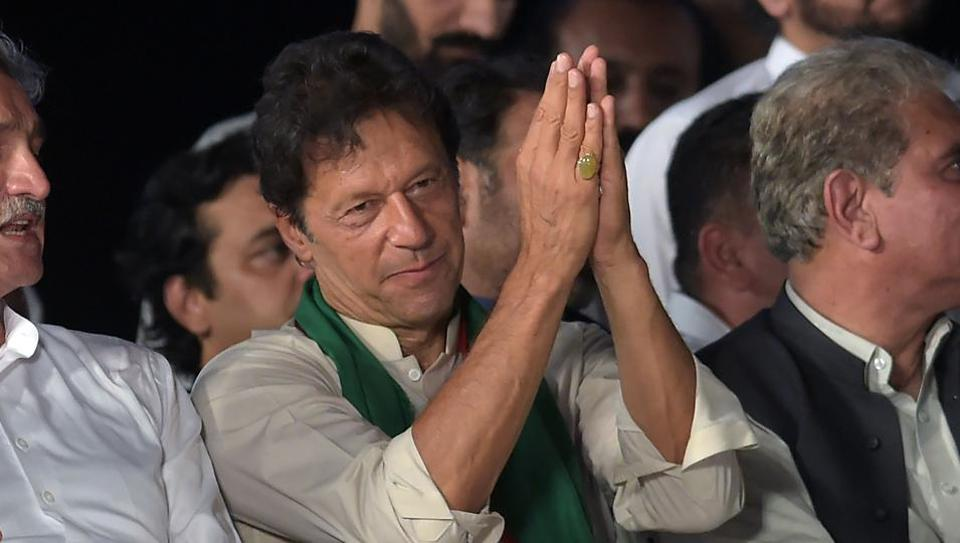 Pakistani opposition leader and head of the Pakistan Tehreek-i-Insaf (PTI) party Imran Khan speaks to supporters during a rally in Islamabad.