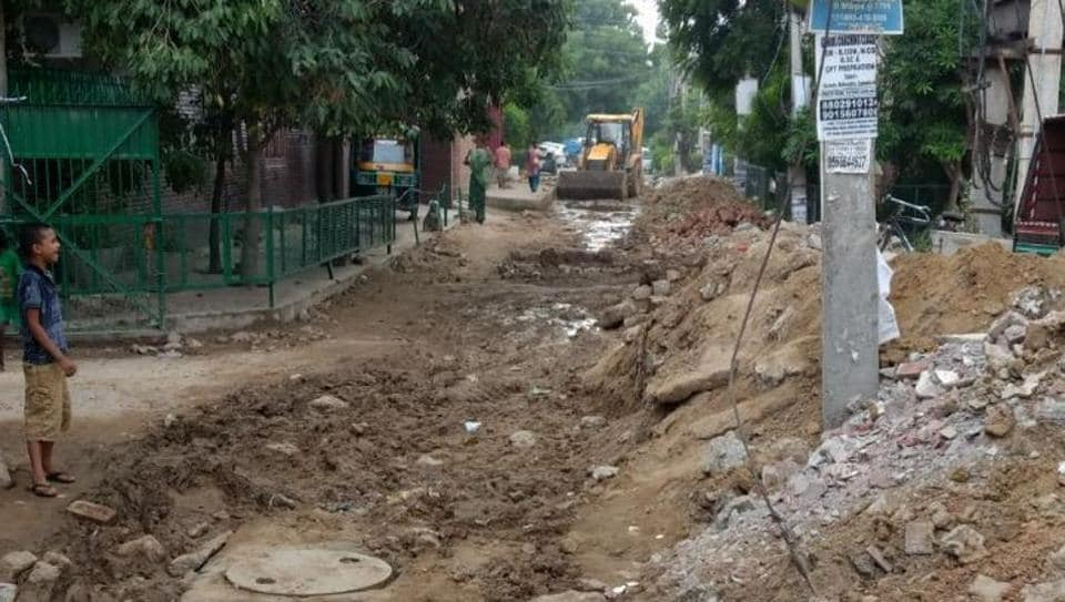 One of the roads dug up in Sector 21 to lay water and sewage lines.