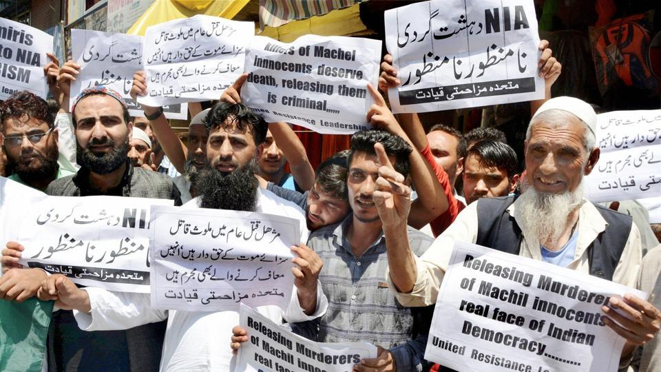Separatist leaders and protesters demonstrate against an army court's verdict on Machil 'encounter', in Srinagar.