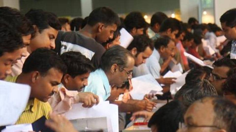People submitting their Income tax return form at Pragati Maidan in New Delhi.