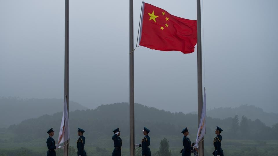 The Chinese flag being raised during the opening ceremony of the International Army Games 2017 in Guangshui in China's central Hubei province.