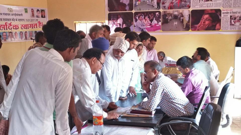 Villagers at the community mediation centre at Araiyawali village in Hanumangarh.