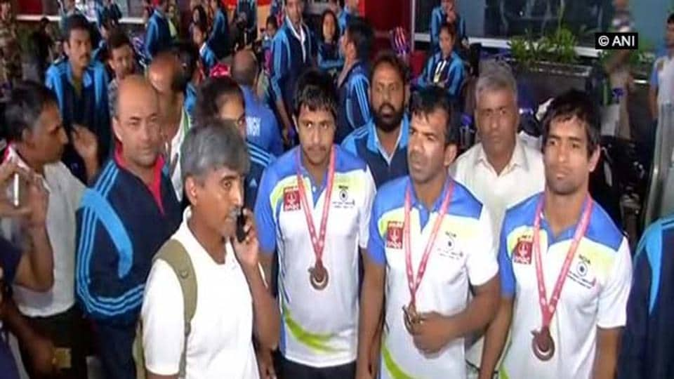 Indian Deaflympics athletes at the New Delhi airport on Tuesday.