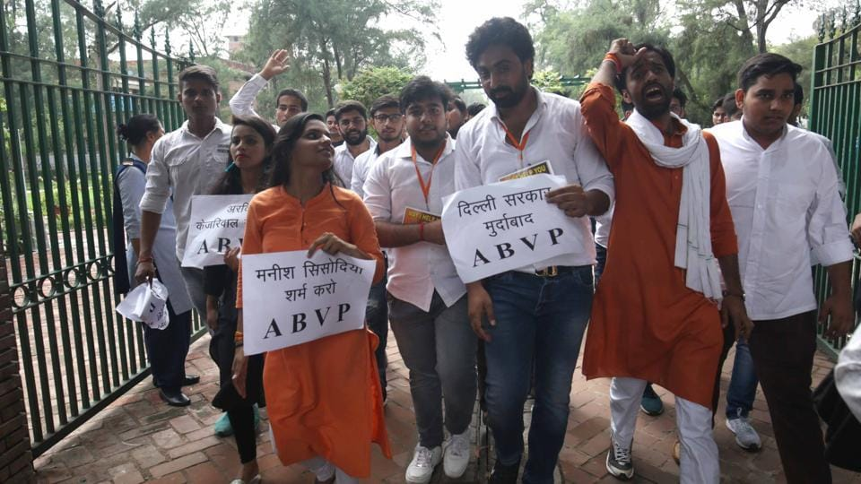 Members of the Akhil Vidyarthi Parishad (ABVP) and Delhi University Students' Union (DUSU) protested outside Arts Faculty in North Campus against Delhi government's decision to stop funding to 28 DU colleges.