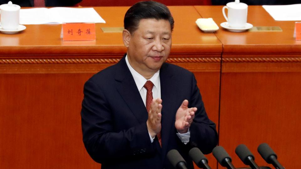 China's President Xi Jinping claps hands during the ceremony to mark the 90th anniversary of the founding of the China's People's Liberation Army at the Great Hall of the People in Beijing on August 1.