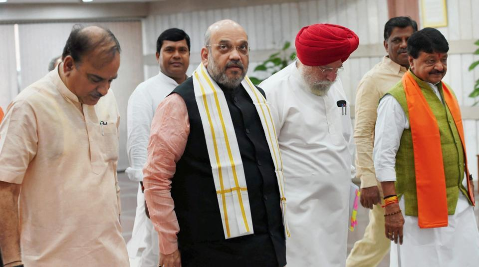 BJP president Amit Shah, Parliamentary affairs minister Ananth Kumar (left), and minister of state SS Ahluwalia arrive to attend BJP parliamentary party meeting, in New Delhi on Tuesday.