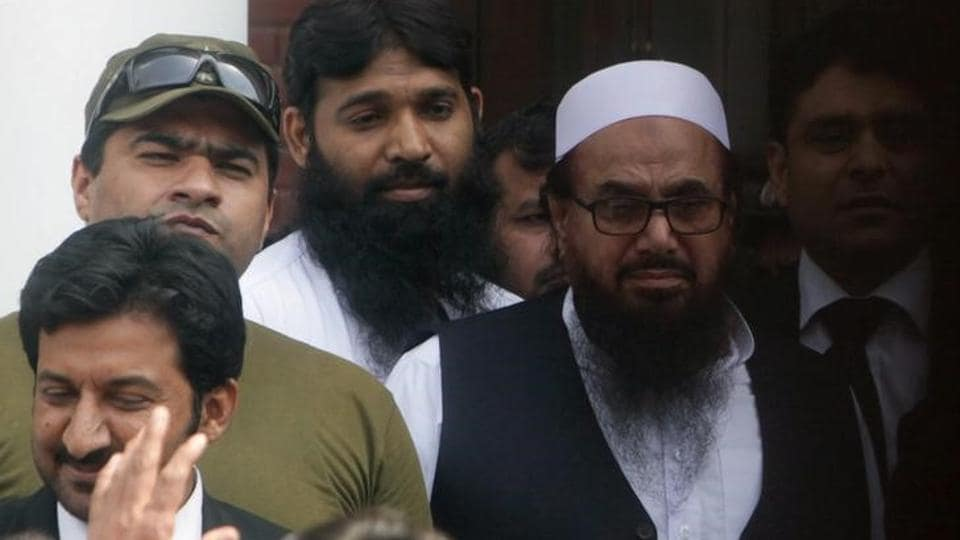Hafiz Saeed, chief of the Jamaat-ud-Dawa (JuD), leaves after a court appearance in Lahore. (REUTERS File Photo)