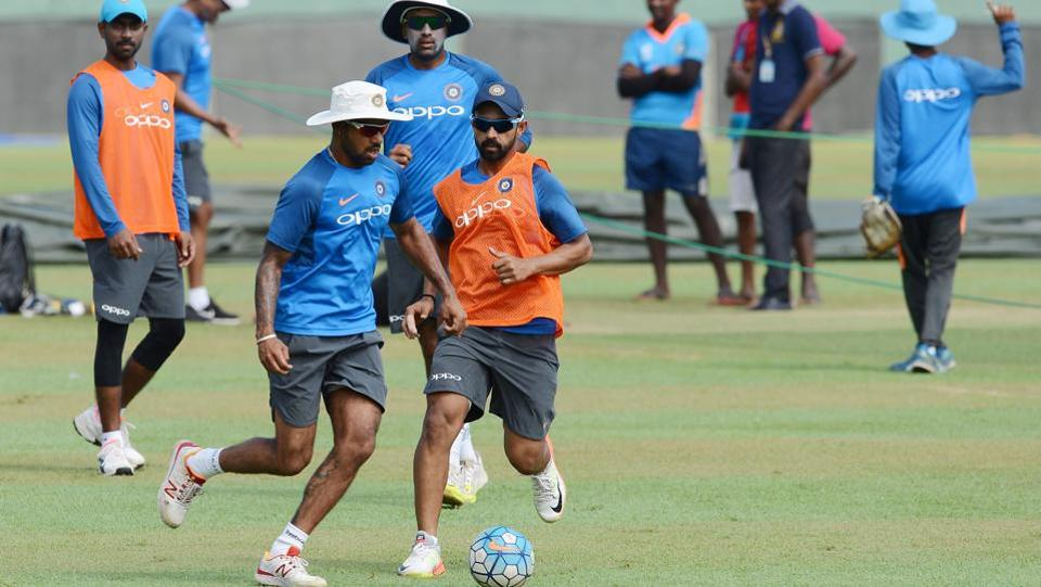 Shikhar Dhawan plays football with his teammates before the nets sessions began in earnest.  (AFP)