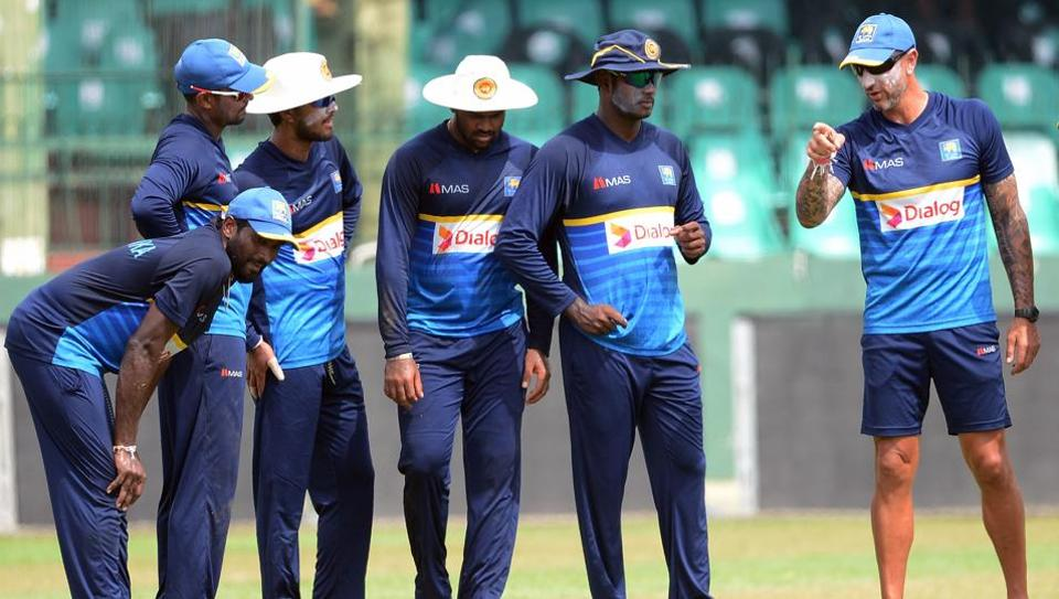 Sri Lankan cricket coach Nic Pothas instructs players during a practice session at the Sinhalease Sports Club (SSC) Ground in Colombo.  (AFP)