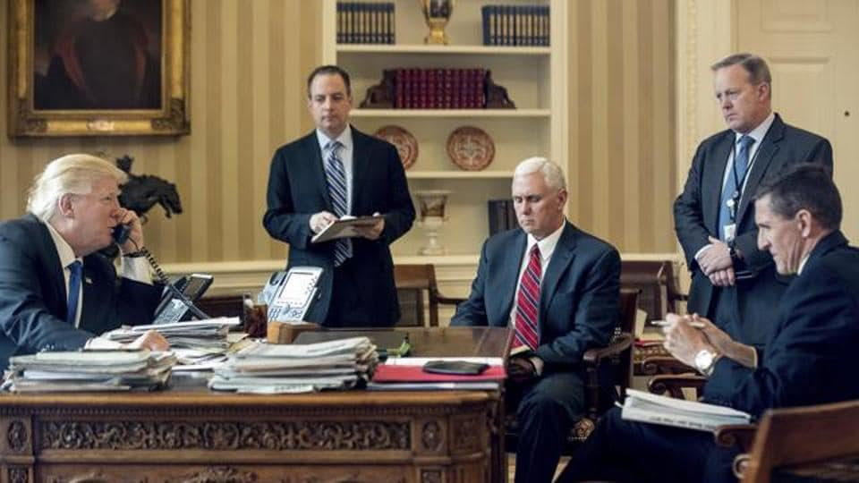 In this January photo, US President Donald Trump and vice president Mike Pence (third from left) are accompanied by then chief of staff Reince Priebus, White House press secretary Sean Spicer and national security adviser Michael Flynn. Almost eight months later, all of those White House staffers  have left the administration.