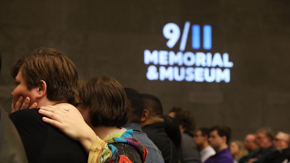 People attend a ceremony for the 15th anniversary of the end of the nine month recovery effort at the 9/11 Memorial and Museum on May 30 in New York City.