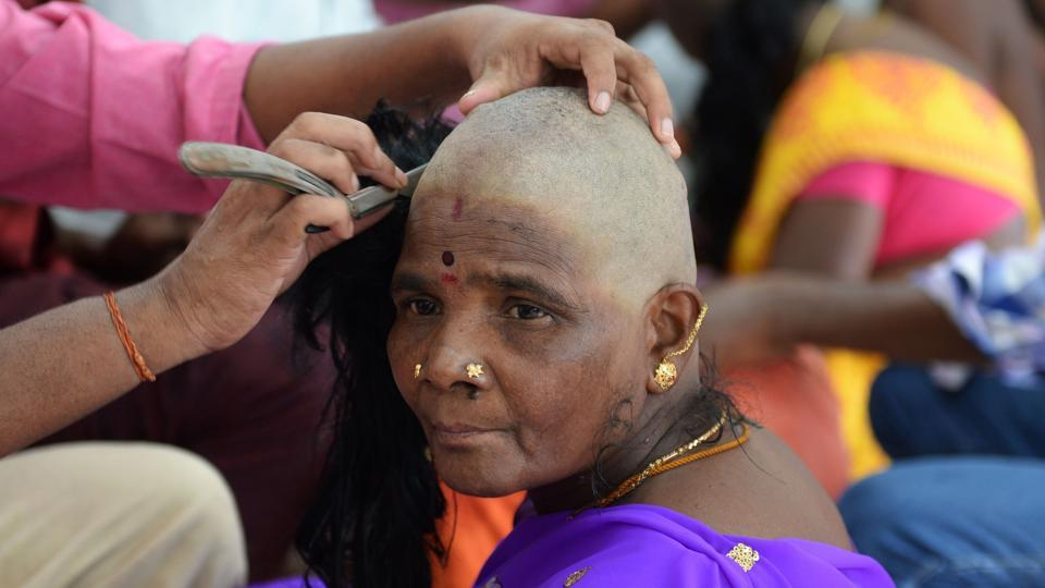 The donation of hair at Hindu temples across India is considered an act of devotion by millions, symbolising a ritualistic purification and a repayment of the debt to the gods. This sacrifice on the part of the devotee also translates into big bucks for the Indian and international fashion and wig making industries.  (Arun Sankar / AFP)
