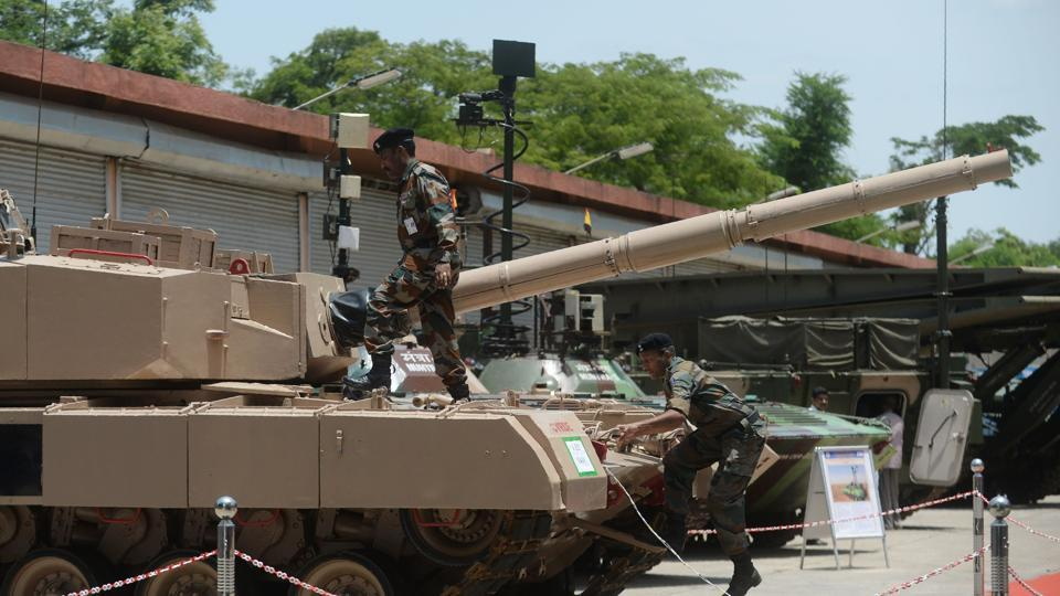 Indian Army soldiers check an Arjun tank during a Defence Research and Development organisation (DRDO) exhibition, in Chennai on July 28, 2017.
