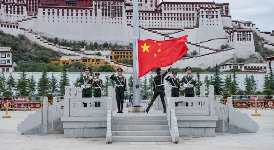 The Chinese national flag is raised during a ceremony marking the 96th anniversary of the founding of the Communist Party of China (CPC) at Potala Palace in Lhasa, Tibet Autonomous Region, China on July 1.