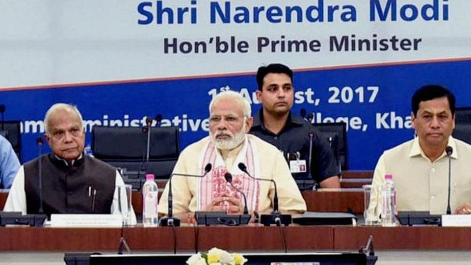 Prime Minister Narendra Modi chairing a high-level meeting to review the flood situation and the relief operations in the North-Eastern states, in Guwahati on Tuesday.