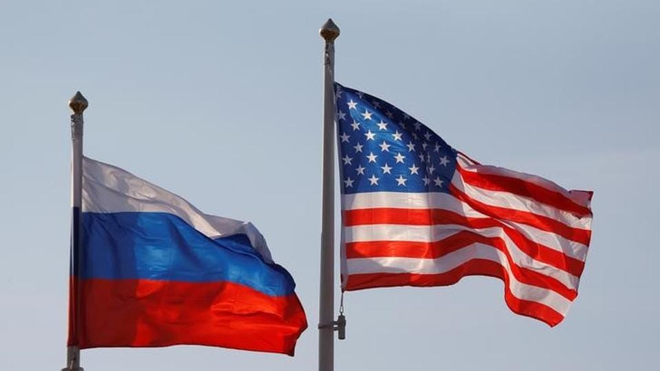 The national flags of Russia and the US fly at Vnukovo International Airport in Moscow, Russia.