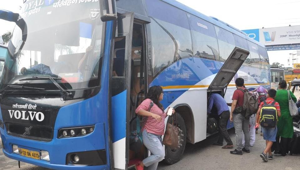 Passengers getting off from a bus at ISBT in Dehradun.